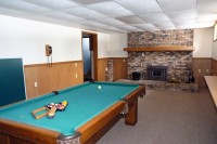 basement family room with fireplace