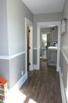 hallway by main level bath, from kitchen